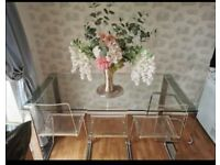 Dinning glass table and six perspex chairs