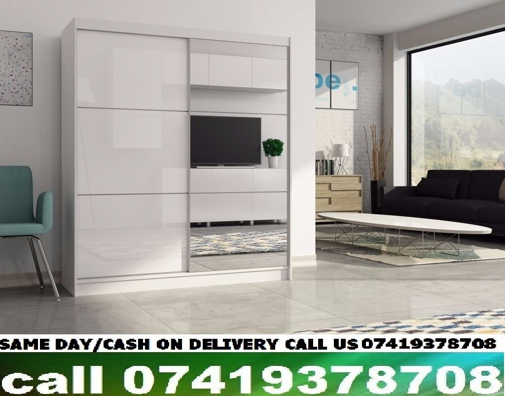 MEO Sliding Two Door High Gloss Black/White Wardrobein West End, LondonGumtree - This high quality modern Two Door Venice sliding door Wardrobecomes in rich colourbeautiful finish and is now available in High Gloss. Dimensions Height 215 cm Width 180 cm Depth 61 cm Specifications 6 Shelves 2 Hanging Rails High Gloss on one Door...