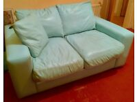 Retro style 2 seater leather sofa in bright blue