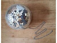 Large glitter/disco ball and chain. Party or fun decoration