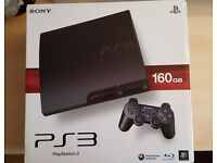 PS3 160GB black boxed in mint condition with games and new dualshock controller
