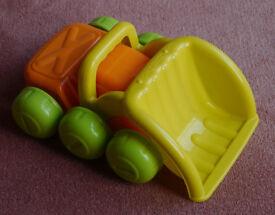 Toy plastic dumper truck