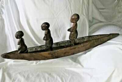 African wood carving canoe with 3 figures