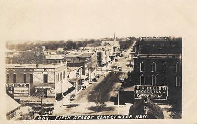 Rppc Clay Center  Ks 5Th Street Scene Eg Elliott Groceries Schlitz 1912 Postcard