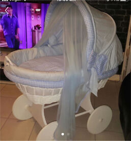 Large blue crib with wheels