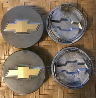 Holden VT-VE Chevrolet bowtie wheel caps.