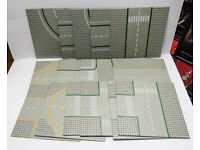 16 Lego base Plates with a variety of road markings on.