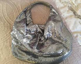 AS NEW: Silver sequined slouch handbag.