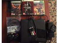 Xbox 360 Slim 250GB with 3 games, a controller and headset