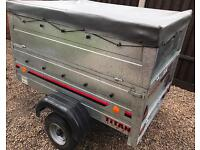 TRAILER WITH HIGH REMOVABLE SIDES.