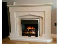 Electric fire with hand carved stone surround