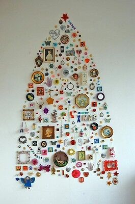 A pretty tree full of keepsakes. Credit: apartmenttherapy.com