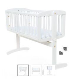 Mothercare white swinging crib.