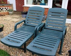 For sale 2 green garden loungers