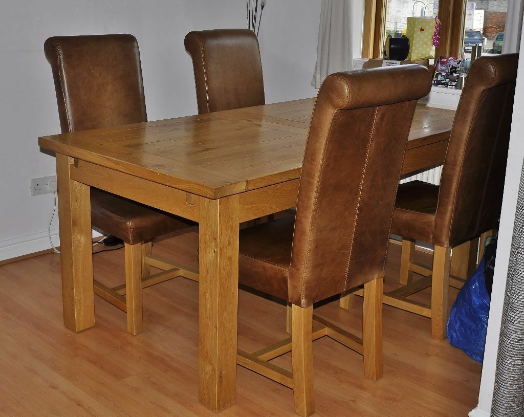 chunky oak extending dining table and 4 halo real leather dining chairs