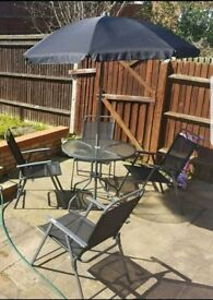Garden table 4 chairs and umbrella