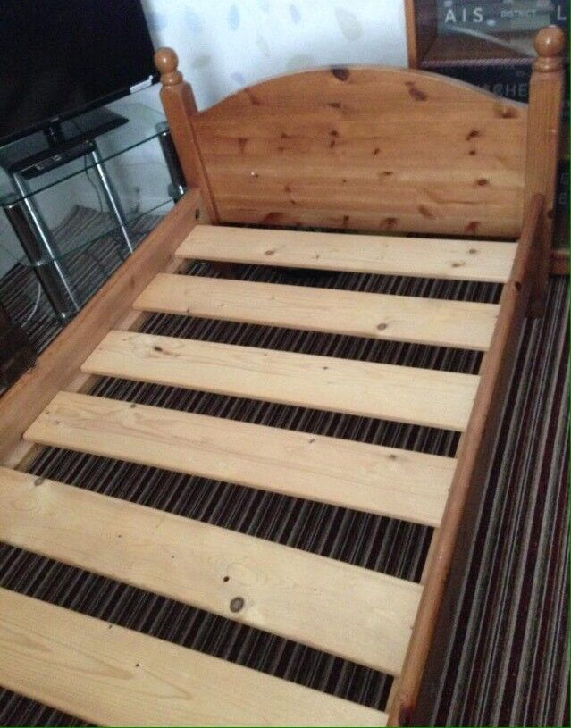 2 solid wooden single beds