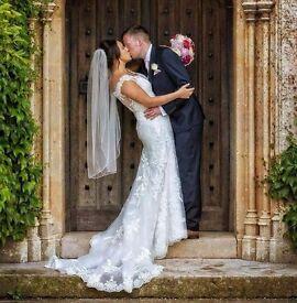 Beautiful lace detail ivory wedding dress with train. Size 12