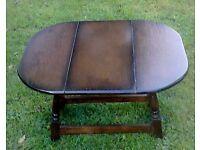 Small dark wood folding coffee table.