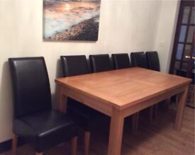 Extending dining table and 6 chairs