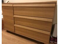 Chest with three drawers and one cupboard with shelves