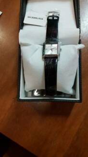 Givenchy Ladies GV.5200L/02A White  Black Leather Band Swiss Made