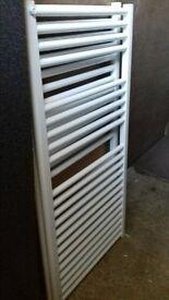 Two unused heated towel rails.