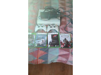 xbox 360 console with 2 wireless controllers and hardrive and 4 games