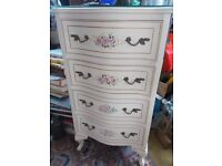Vintage shabby chic painted chest of drawers with flowers.