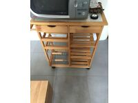 Wooden butchers block with white tile top