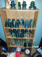 Well over 150 various glass and porcelain insulators