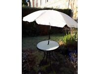 Garden table with umbrella