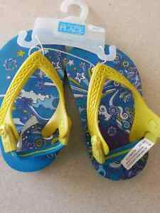 Little girl Blue and yellow flip flops