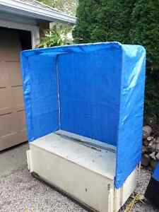 Ice fishing shanty/storage box on skis 40.00  new boat cover 75.