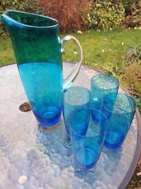Blue glass jug and glasses