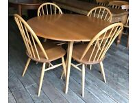 Ercol Extending Drop Flap Dining Table With Four Chairs