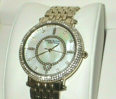 Anne Klein Women's 12/2312MPGB Crystal Accented Gold Tone Watch w/ MOP Dial