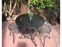Black marble garden table and chairs