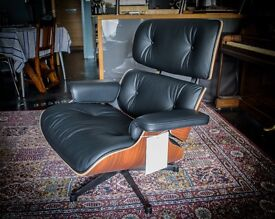 Genuine, new Eames Lounge chair. Pallisander, black (Nero) premium leather Vitra
