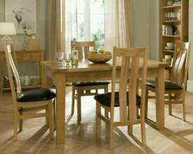 Oak dinning table and chairs with matching sideboard and display cabinet.