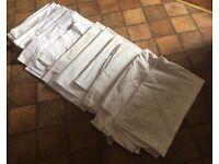 Ten white linen sheets