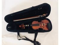 Children's 1/4 violin with case and 4 new sets of strings