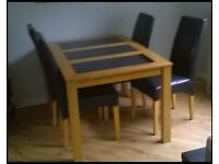 Oak Table with granite inserts and 4 leather chairs