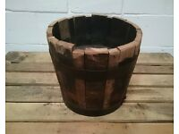 Wooden half-barrel planter