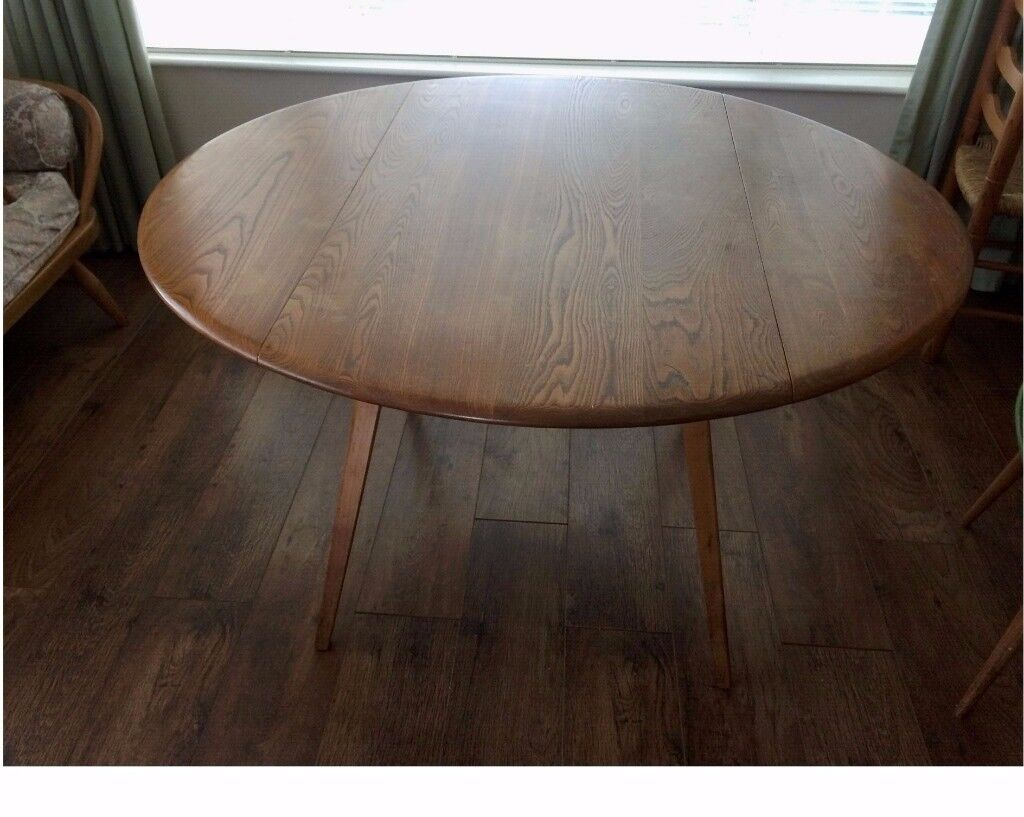 Ercol light elm dining table and 4 chairs. Vintage 60's original drop leaf table