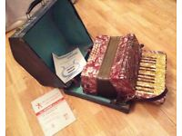 Alvari accordion, case and learner books