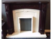 Dark wood & light marble fire place