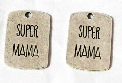 5 Colgantes chapas super mama, zamak, abalorios,fornituras, collares, pulseras,