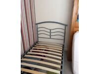 Single metal bed frame with mattress