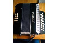Primo 2 row D/G diatonic button accordion (melodeon) with strap and carry bag